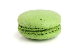 green macaron isolated on white background closeup