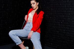 Stylish brunette girl on red jacket