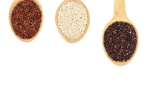 Black red white quinoa seeds in wooden spoon isolated on white background with copy space for your text