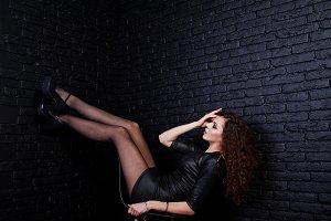 Brunette curly haired long legs girl