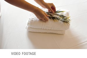 Clean towels with olive branches