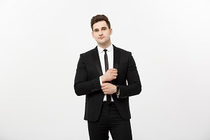 Business Concept: Handsome Man Happy Smile Young Handsome Guy in smart suit posing over Isolated Grey Background.