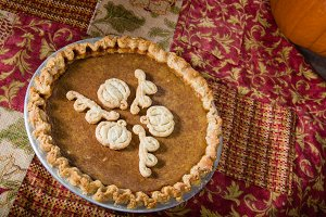 Homemade pumpkin pie with decoration