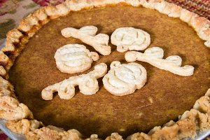 Decorated pumpkin pie