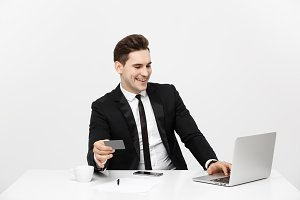 Business and Lifestyle Concept: Portrait smiling businessman sitting in office and shopping online pays by credit card with labtop