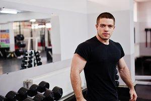 man working hard in gym