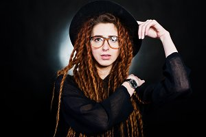 Portrait of girl in dreads at studio