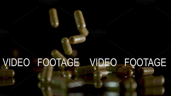 Pill Capsules Falling On The Mirror Table Slowmotion Shot 180 Fps