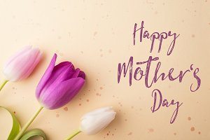 Happy mothers day sign and flowers composition. Studio shot.