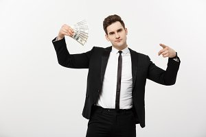Business Concept: Portrait handsome businessman suit holding fan of dollar cash isolated over white gray background.