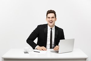 Business Concept: Portrait happy attractive businessman working on laptop at office