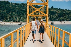 couple walking along the bridge