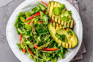 Green salad with grilled avicado. Top view