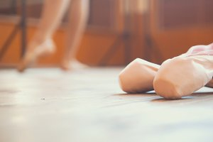 Close up of a ballet dancer's shoe in front of girl