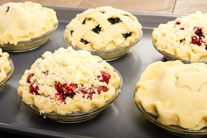 Fruit pies filled and ready to bake