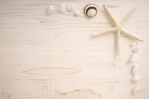 Starfish and seashell on white desk