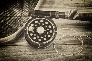 Old Fly fishing gear on rustic wood