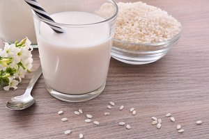 Rice milk on wood  table close up
