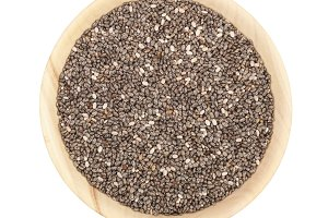 Chia seeds in wooden bowl isolated on white background. Top view