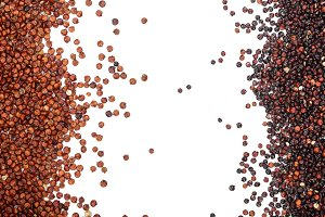 Black and red quinoa seeds isolated on white background with copy space for your text. Top view
