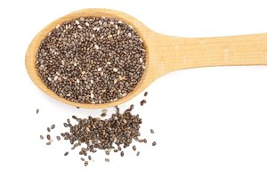 Chia seeds in wooden spoon isolated on white background. Top view
