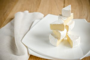 Slices of Camembert on the plate