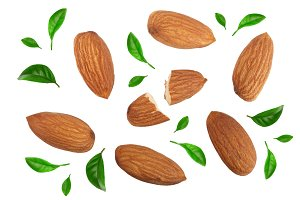 almonds decorated with leaves isolated on white background. Top view. Flat lay pattern