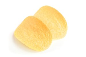 two potato chips on white background close-up