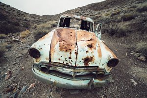 OLd abandoned rusty retro car