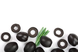 whole and sliced black olives isolated on white background. Top view. Flat lay pattern