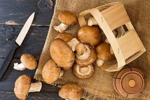 Brown mushrooms and kitchen knife. Top.