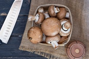 Basket with champignons. Kitchen knife. Knife chef.