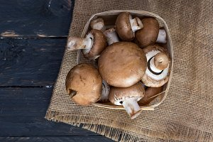 Basket of fresh mushrooms. Brown champignons.