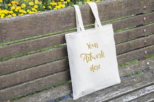 Tote bag on bench mockup