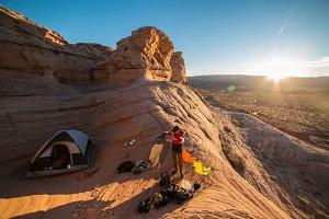 tourist man preparing campground