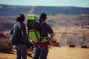 Tourist couple hiking with backpacks