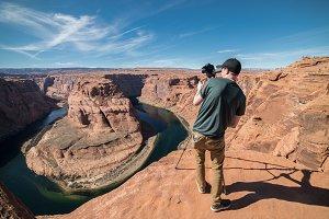 Tourist man take photo Grand Canyon