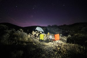 Night camping with tent in desert