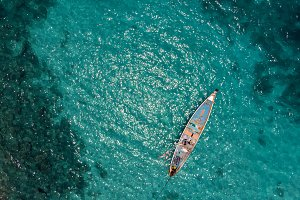 aerial view of traditional fisher boat in turquoise sea