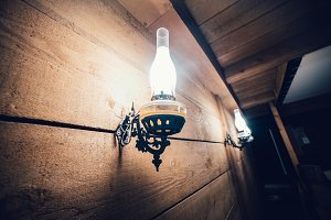 Old vintage electric lamp on wooden