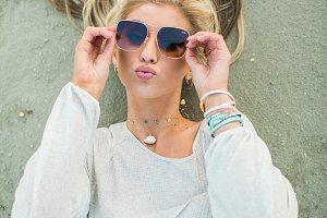 Beach girl with sunglasses & jewelry