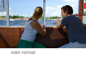 Man and woman having a trip on boat