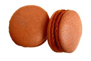 chocolate macaron isolated on white background without a shadow closeup. Top view. Flat lay