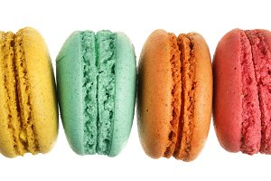 colored macarons isolated on white background without a shadow closeup. Top view. Flat lay