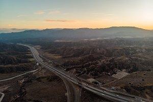 Desert asphalt road with cars