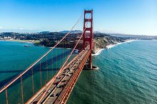 Cars moving on Golden Gate bridge by Nick Starichenko in Transportation