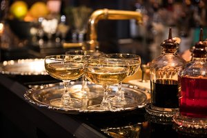 Champagne drinks in glasses on bar