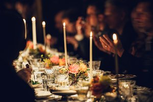 People enjoy family candles dinner