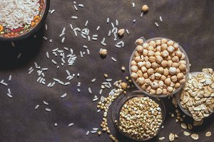 overhead set of raw seed grains cereals in the plates