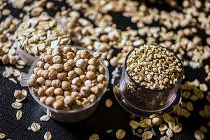 close up macro raw seeds and grains oatmeal, rice and cikpea